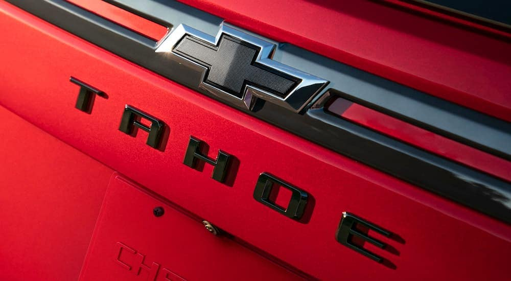 A red 2021 Chevy Tahoe RST's black bow tie logo is shown.