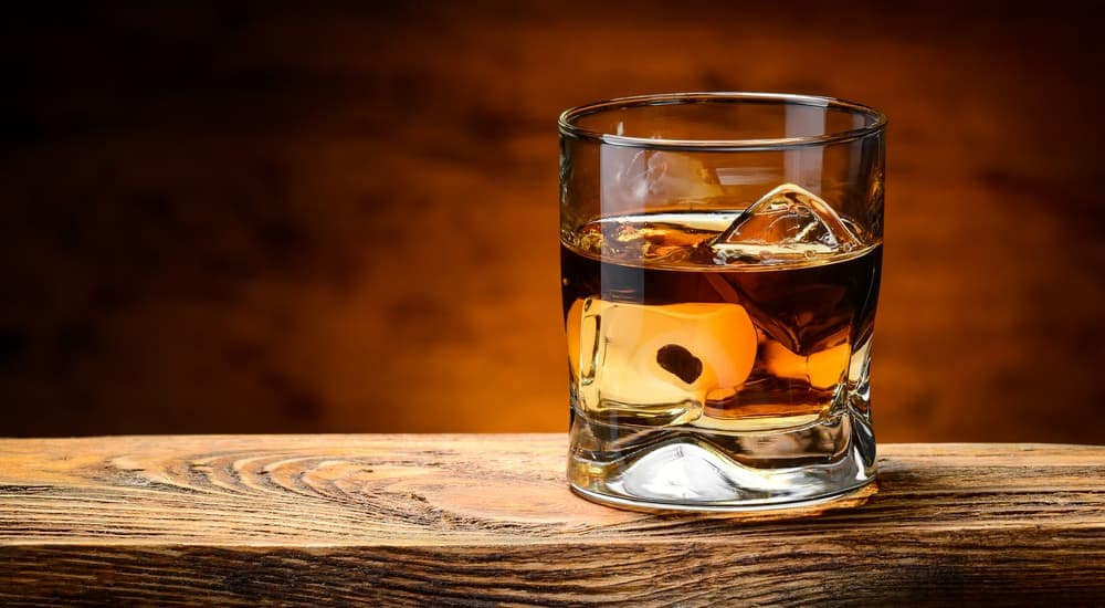 A glass of whiskey is on a wooden table at Yankee Distillers LLC in Clifton Park, NY.