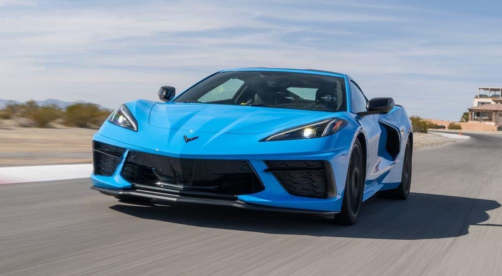 A blue 2020 Chevy Corvette racing around a test track.