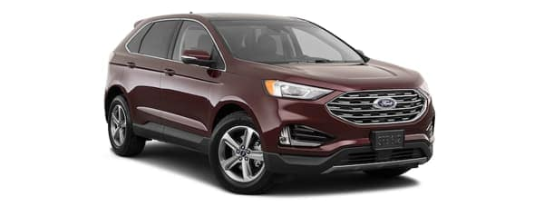 A burgundy 2020 Ford Edge is facing right.