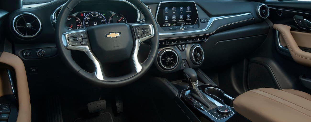 The tan and black interior of a 2020 Chevy Blazer, which wins when comparing 2020 Chevy Blazer vs 2020 Jeep Cherokee.