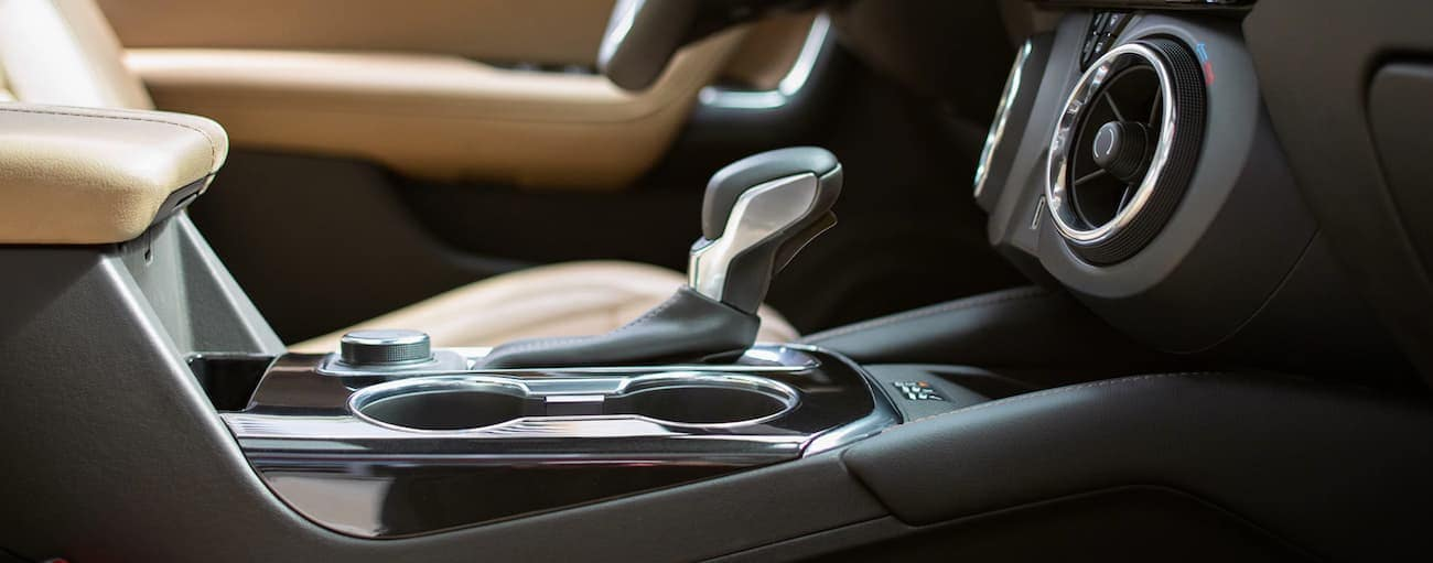 The black and tan interior in the 2020 Chevy Blazer is shown with a closeup of the shifter