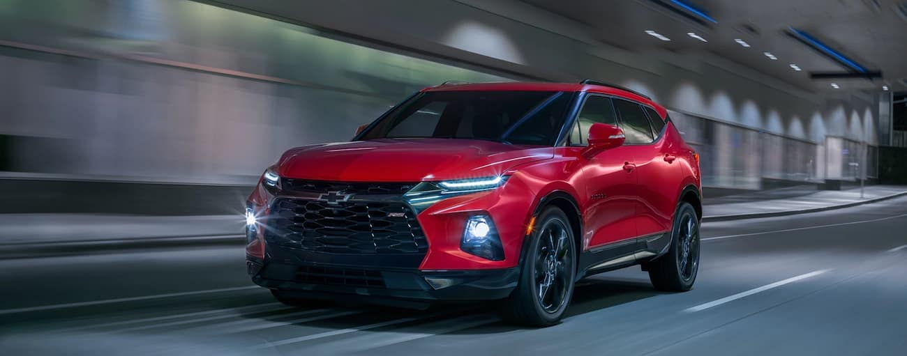 A red 2020 Chevy Blazer, which wins when comparing the 2020 Chevy Blazer vs 2020 Kia Sorento, is driving in a tunnel near Albany, NY.