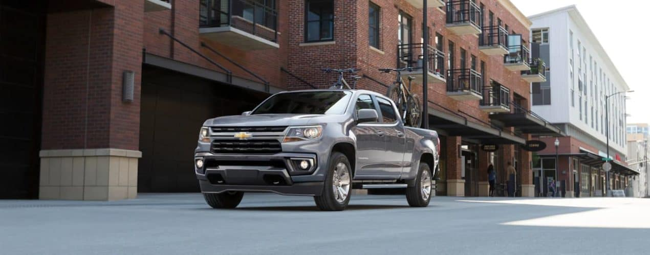A grey 2021 Chevy Colorado is shown parked in a alleyway.