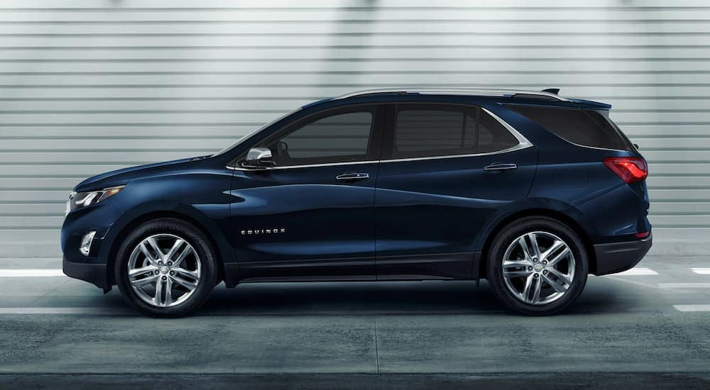 A blue 2020 Chevy Equinox is shown from the side in a parking garage after leaving a Chevy dealer near me in Albany, NY.