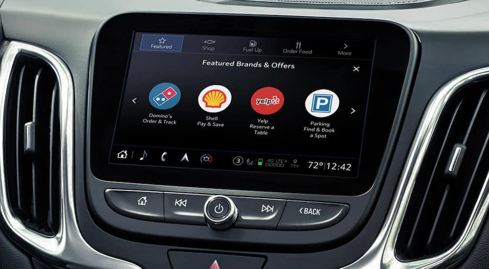 The infotainment display in a 2020 Chevy Equinox is shown with multiple apps.