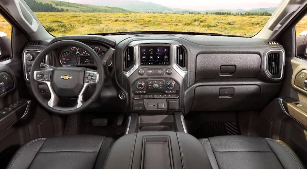 The dark grey front interior of a 2020 Chevy Silverado LTZ is shown.