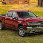 A red 2020 Chevy Silverado LTZ is parked on grass and popular among trucks for sale in Albany, NY.