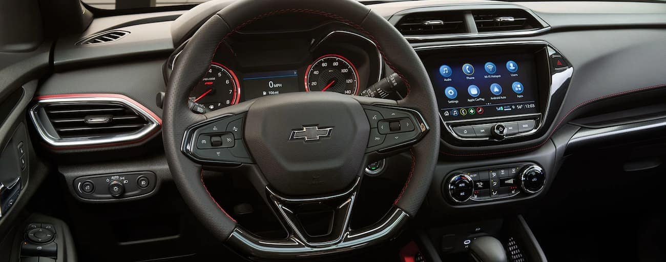The black dashboard and infotainment screen of a 2021 Chevy Trailblazer are shown.