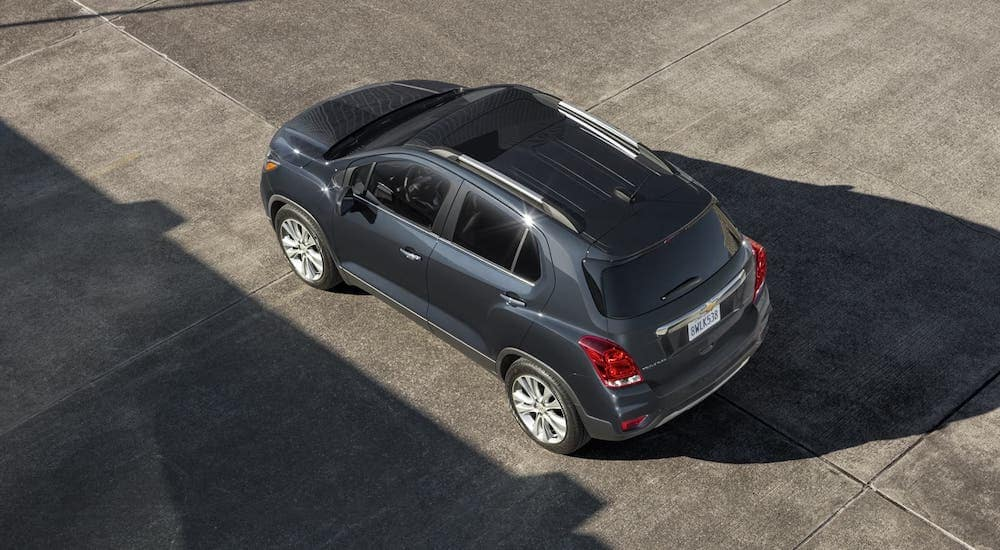 A gray 2020 Chevy Trax is parked in an empty lot and shown from above, check one out at a Chevy Dealership near Clifton Park, NY..