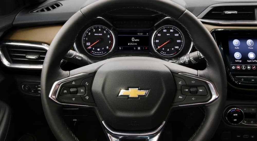 The steering wheel and driver info section is shown in a 2021 Chevy Trailblazer.