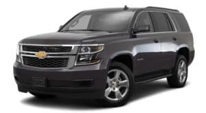 A black 2016 Chevy Tahoe is facing left.