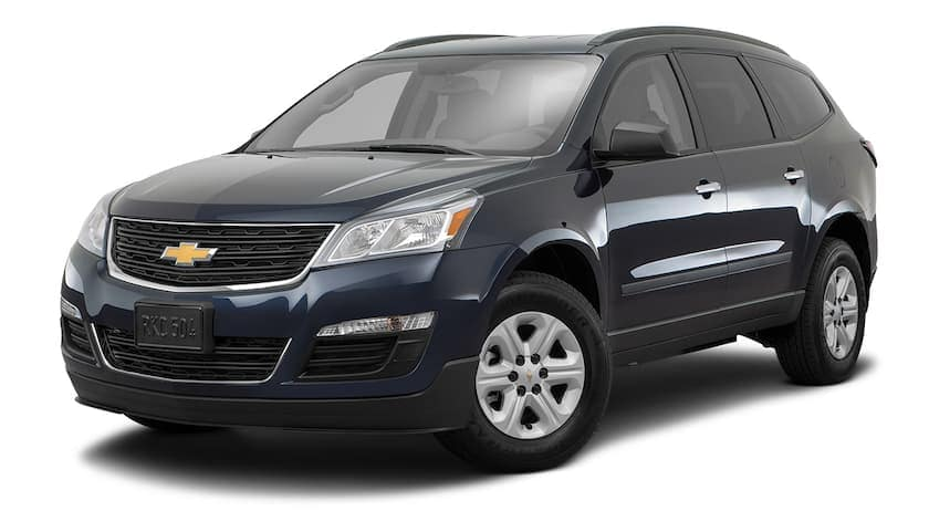 A dark blue 2016 Chevy Traverse is facing left.