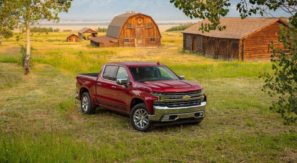 A red 2020 Chevy Silverado LTZ is parked in front of a barn outside Albany, NY.
