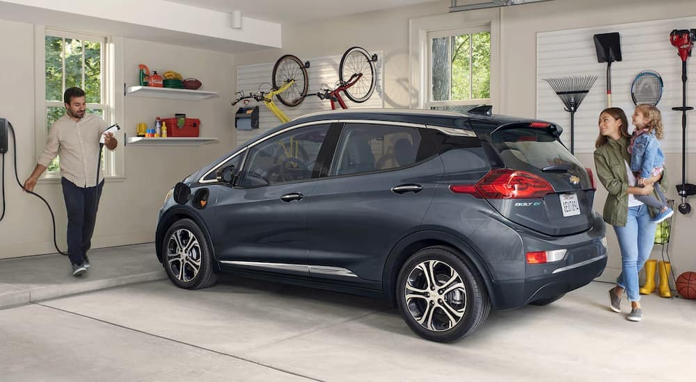 A grey 2020 Chevy Bolt, currently the only electric Chevy SUV, is parked in a family's garage in Albany, NY.