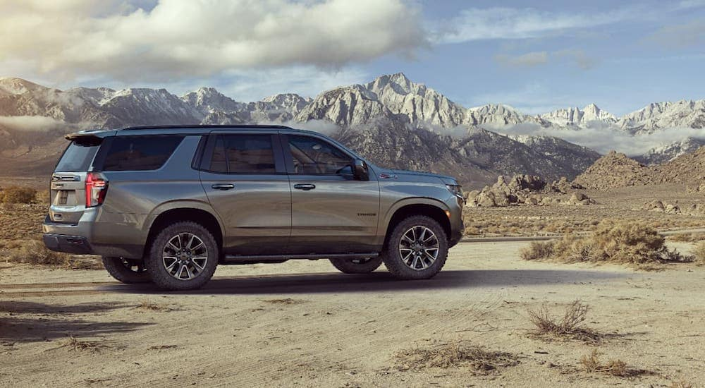 One of the new Chevy vehicles, a gray 2021 Chevy Tahoe Z71, is parked and overlooking mountains.