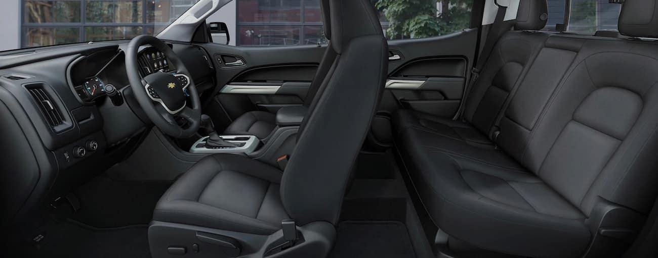 The black interior of a 2020 Chevy Colorado is shown from the side.