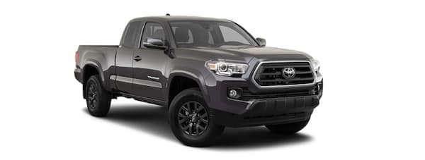 A dark grey 2020 Toyota Tacoma is facing right.