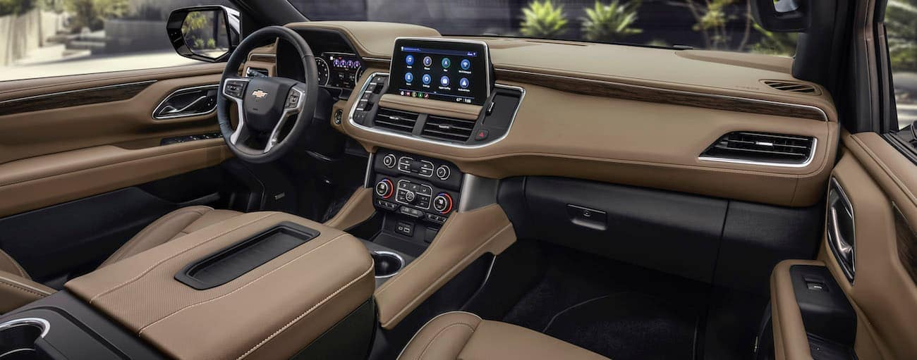 The tan interior of a 2021 Chevy Suburban is shown.