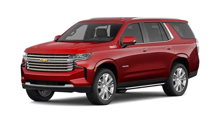 A red 2021 Chevy Tahoe is facing left.