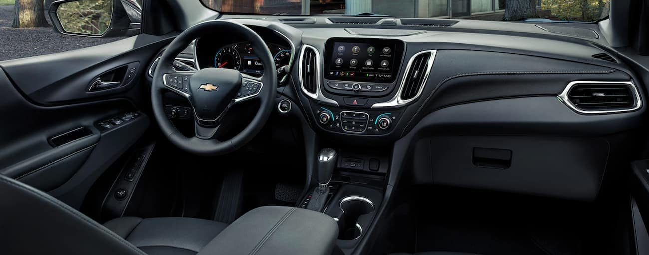 The black interior of a 2020 Chevy Equinox is shown.