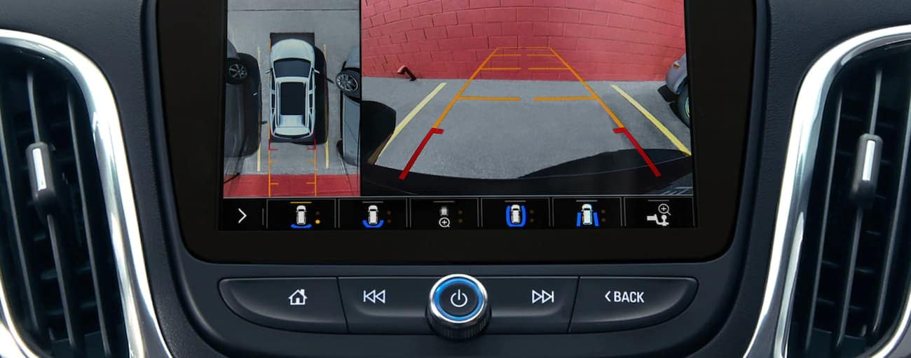 The back up camera view is shown on the screen in a 2020 Chevy Equinox.