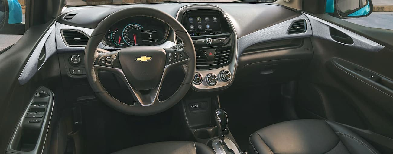 The black interior of a 2021 Chevy Spark is shown.