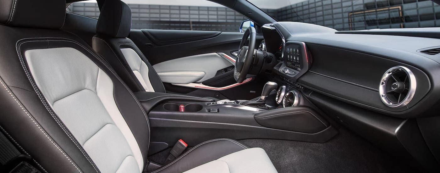 The front seats in a 2021 Chevy Camaro are shown from the passenger side.
