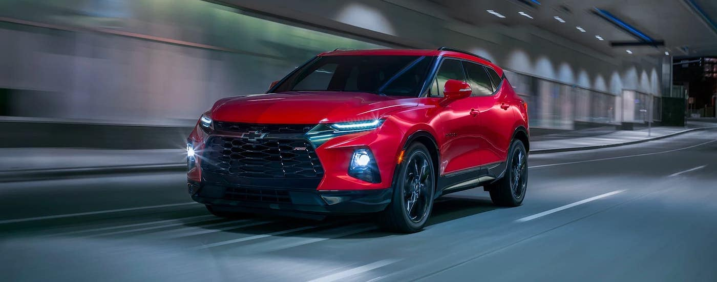 A red 2021 Chevy Blazer RS is driving in a tunnel.