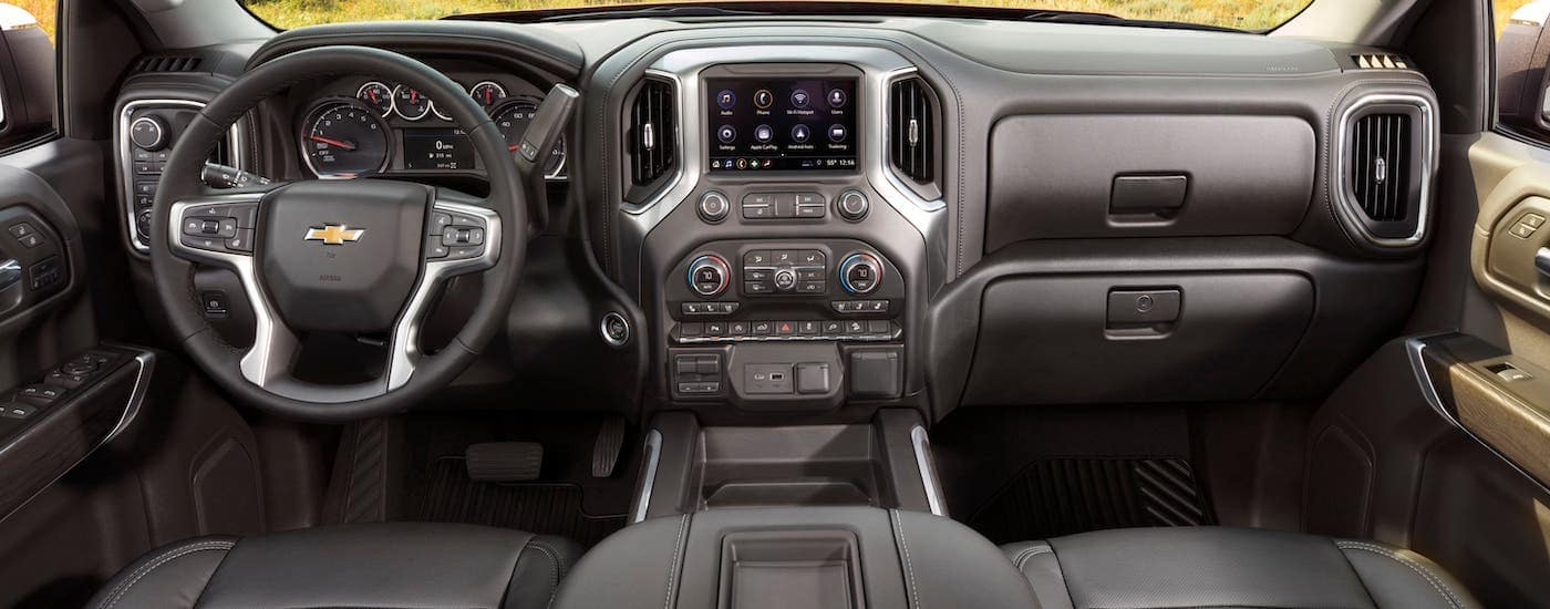 The dashboard and interior of a 2021 Chevy Silverado 1500 are shown.
