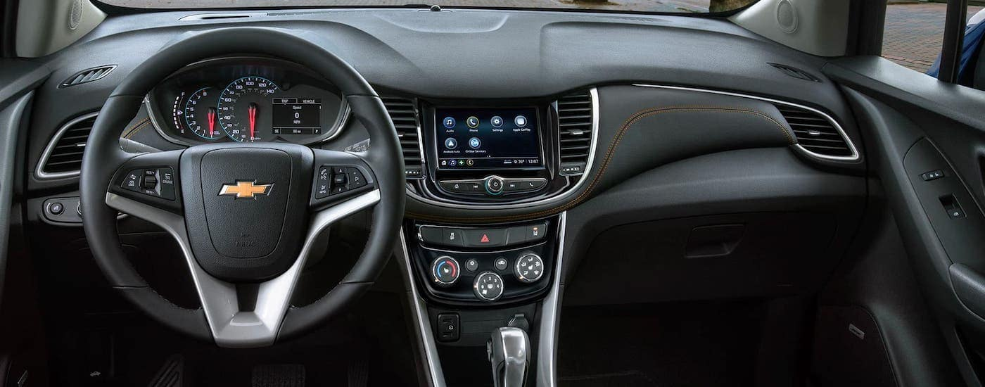 The black interior with orange stitching is shown in a 2021 Chevy Trax.