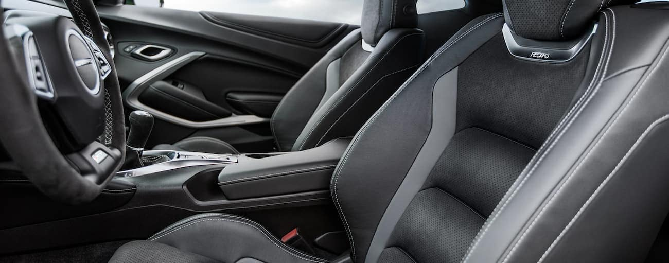 The black interior of a 2021 Chevy Camaro is shown.