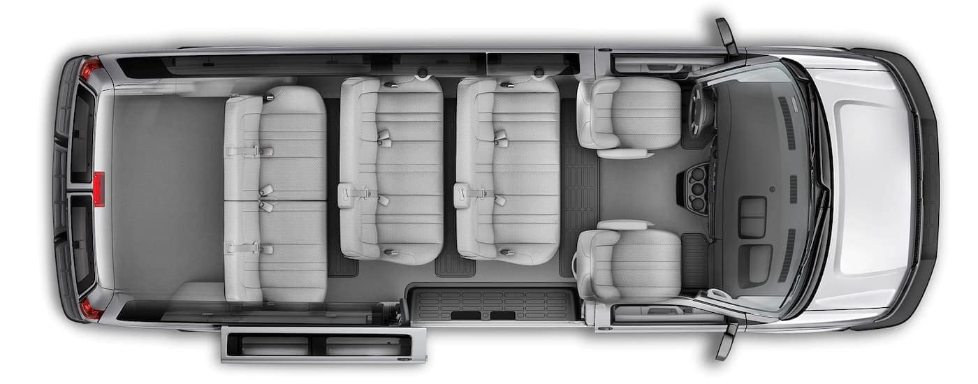 An aerial view is showing the gray interior and seating on a 2021 Chevy Express.