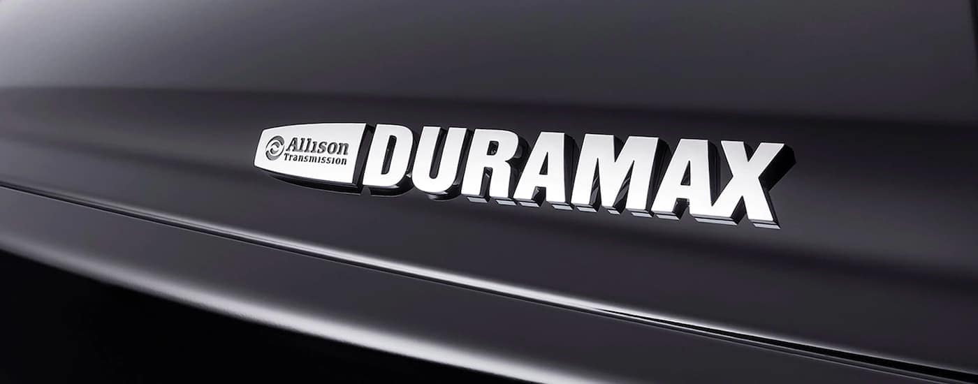 A close up is showing the Duramax and Allison Transmission badging on a 2021 Chevy Silverado 4500 HD.