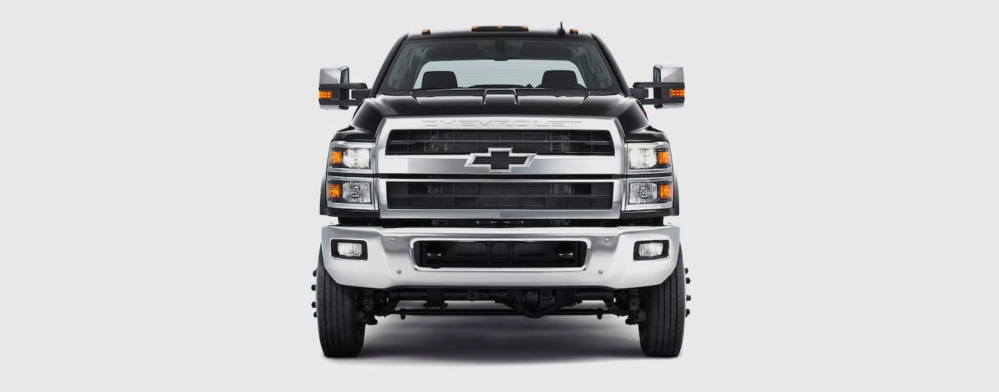 A black 2021 Chevy Silverado 4500 HD is shown from the front against a grey background.