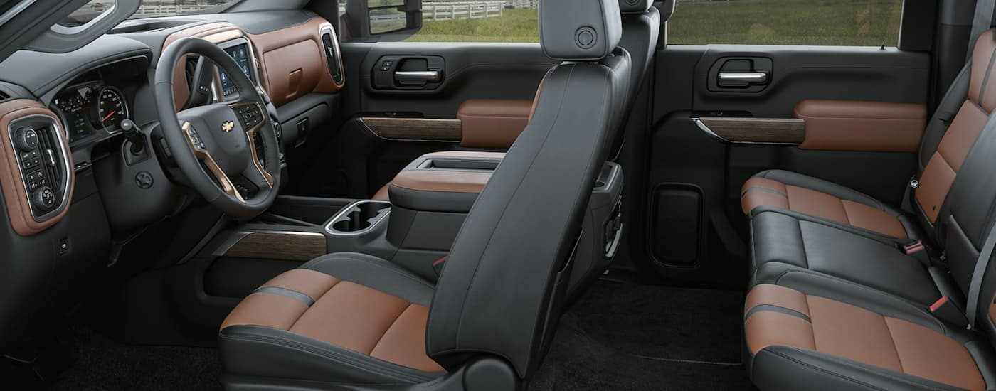 The black and brown interior is shown on a 2021 Chevy Silverado HD 2500 High Country.