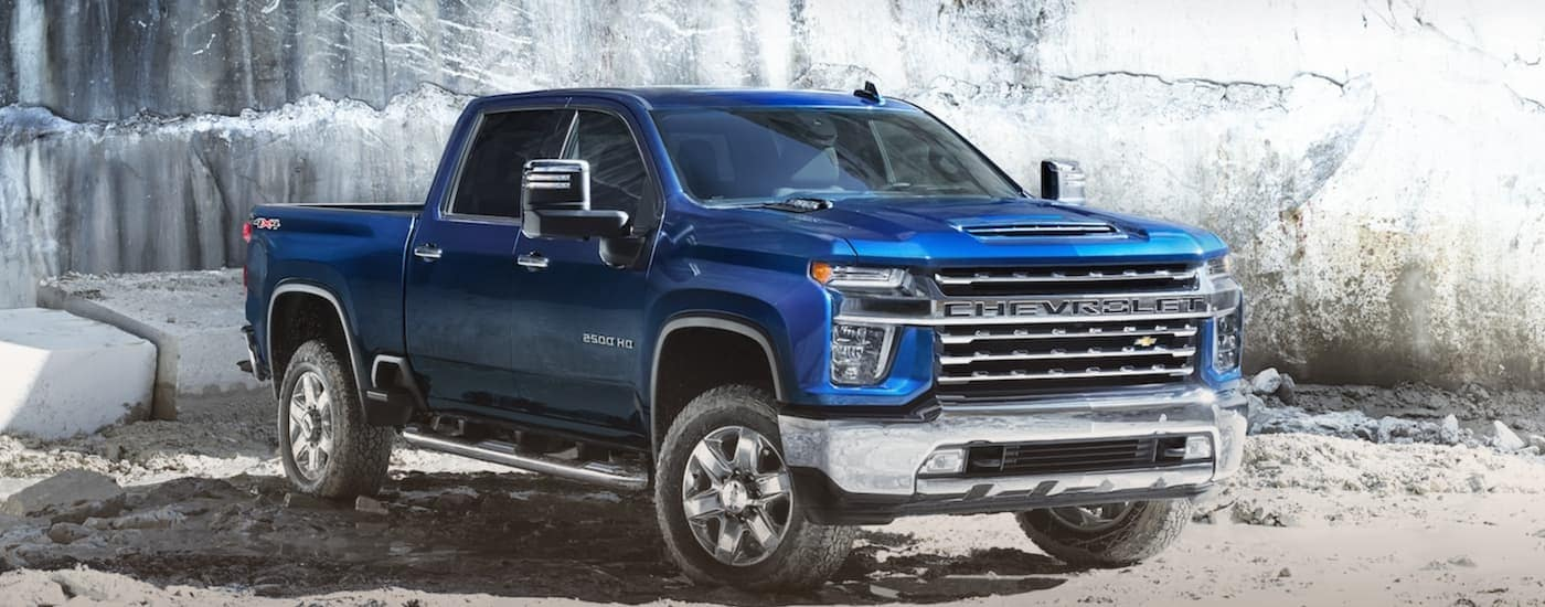A blue 2021 Chevy Silverado HD 2500 is parked in a quarry.