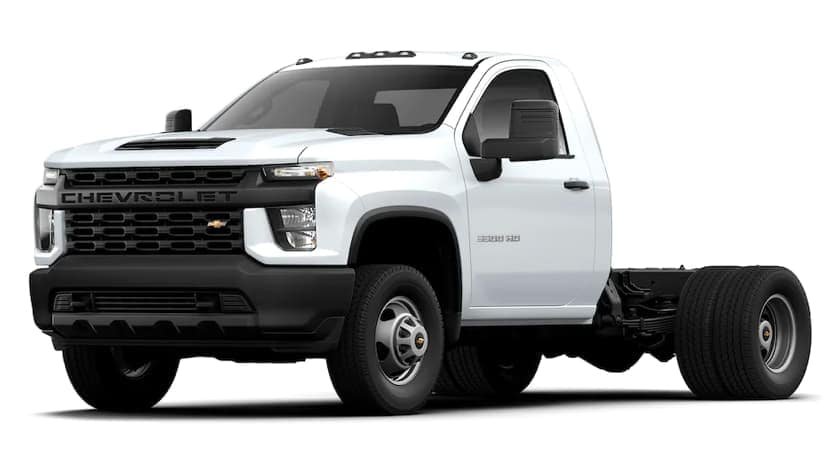 A white 2021 Chevy Silverado 3500 HD Chassis Cab is angled left.