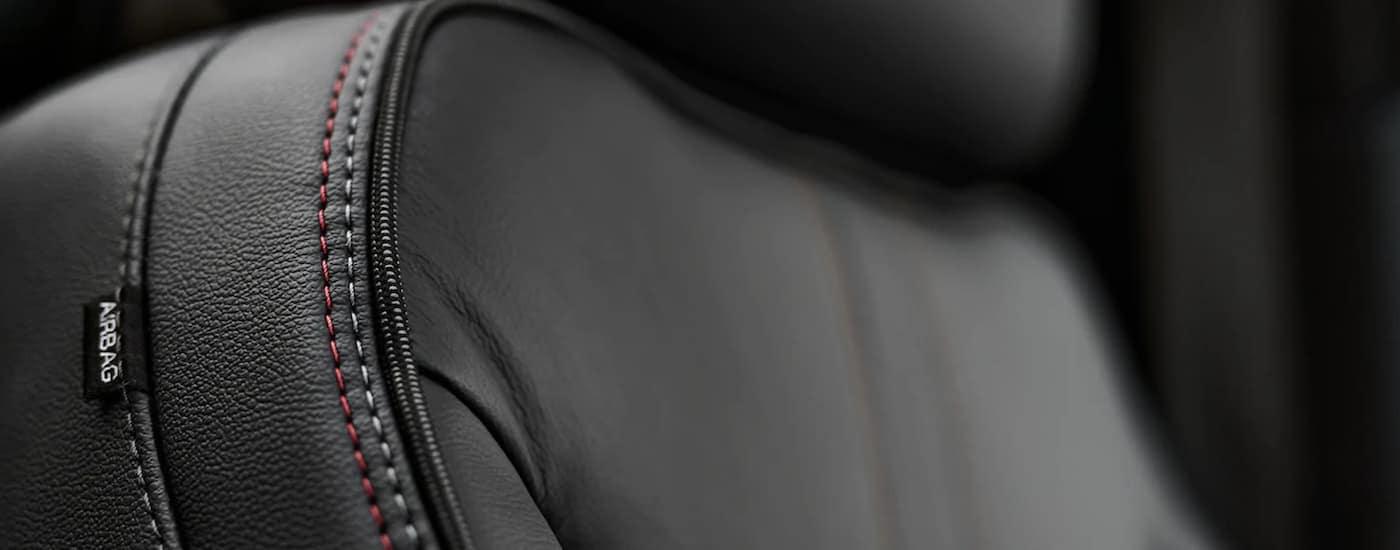 A close up shows the black leather seat and stitching on a 2021 Chevy Tahoe.