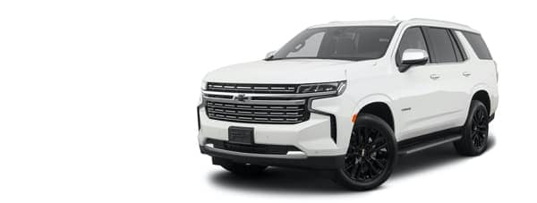 A white 2021 Chevy Tahoe is angled left.