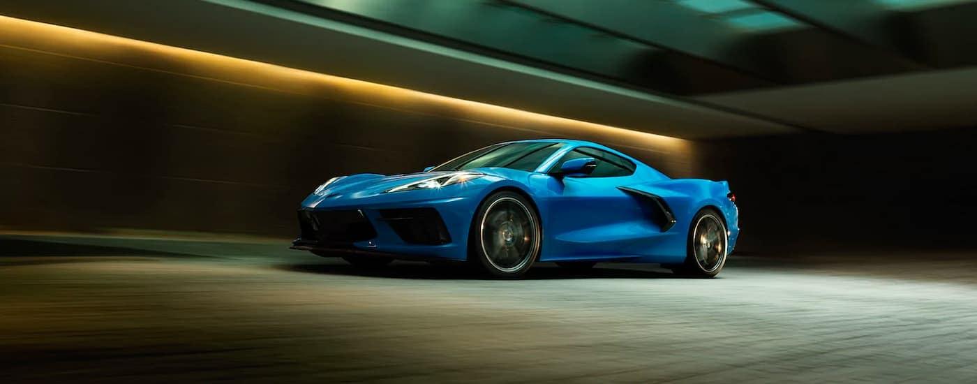 A blue 2021 Chevy Corvette is speeding through a tunnel.