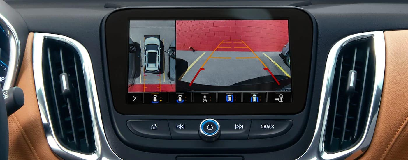 A close up shows the back up camera view on the infotainment screen in a 2021 Chevy Equinox.