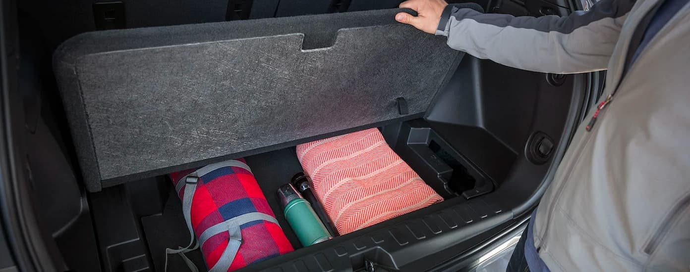 A close up shows a storage compartment in a 2021 Chevy Equinox.