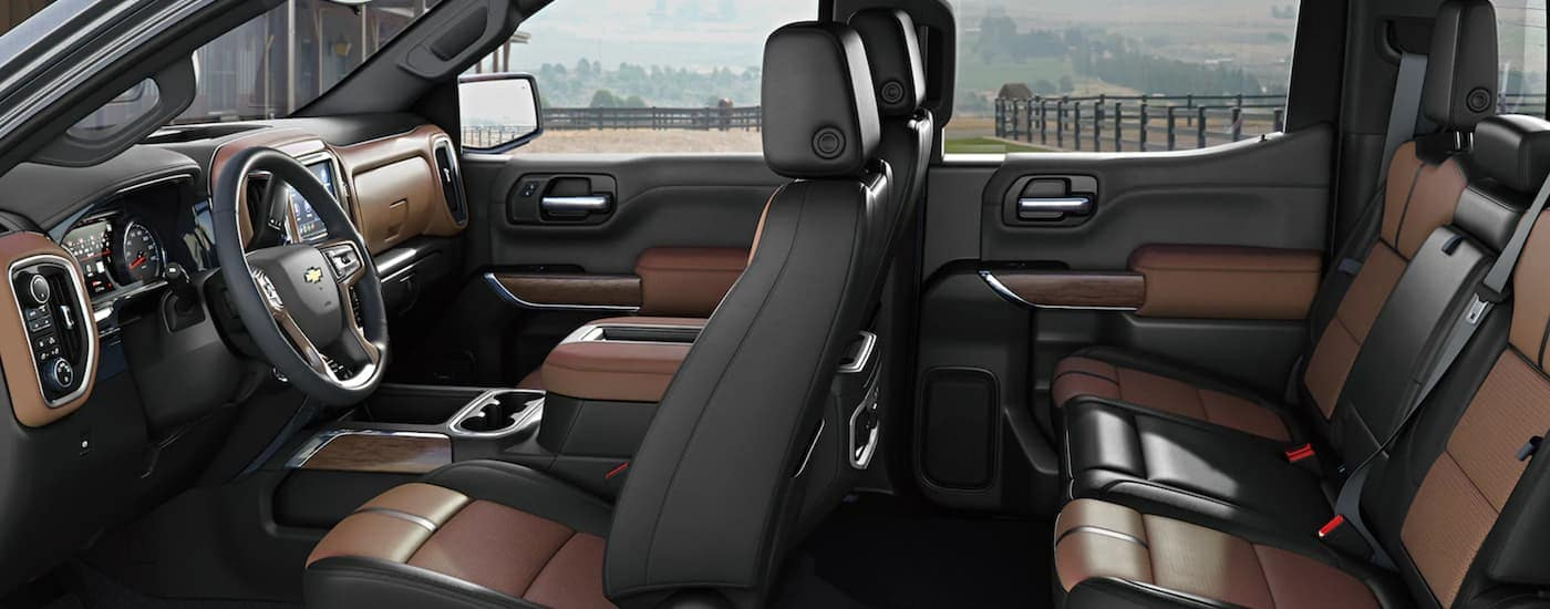 The black and brown interior is shown is shown from the driver side in a 2021 Chevy Silverado 1500.