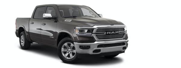 A black 2021 Ram 1500 is angled right.