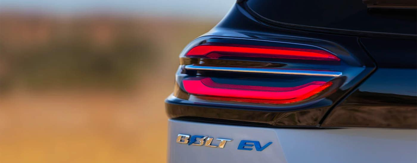A close up shows the tail light and emblem on a silver 2022 Chevy Bolt EV.