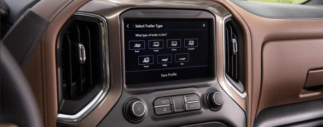 A close up shows the infotainment screen and trailer type screen in a 2021 Chevy Silverado 3500 HD.