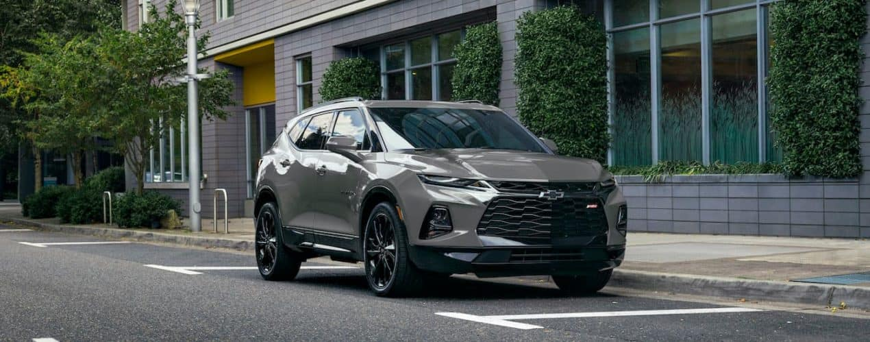 A grey 2022 Chevy Blazer is shown parked on the street.