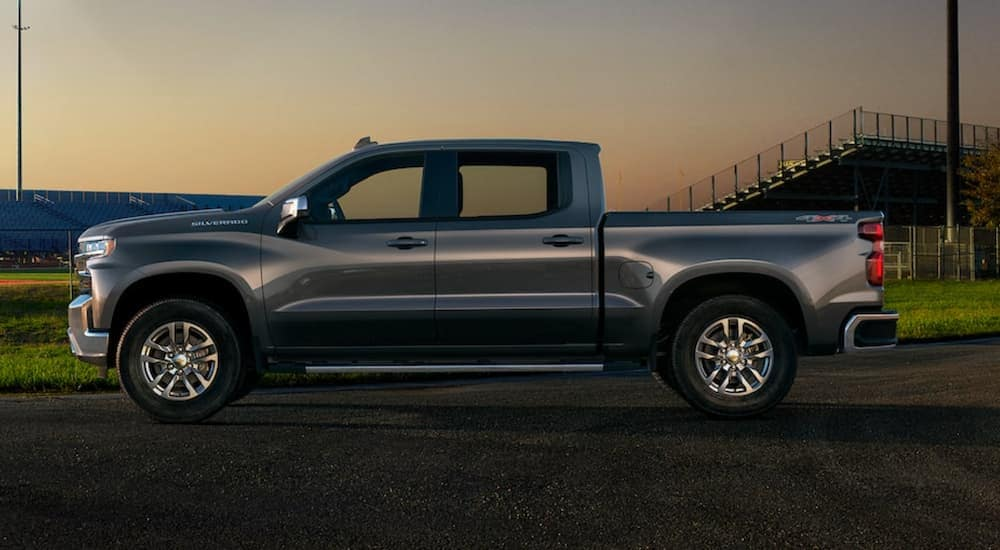 A silver 2021 Chevy Silverado 1500 is parked on a track after leaving a Chevy 1500 diesel dealer.