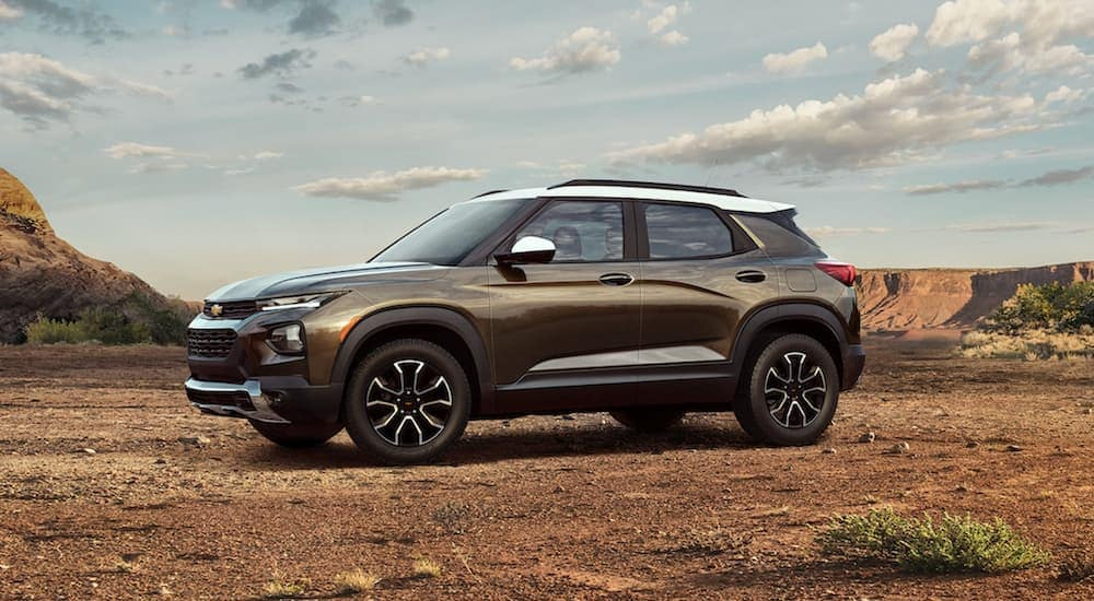 A gold 2022 Chevy Trailblazer Activ is shown parked in a desert after looking for Chevy lease deals.
